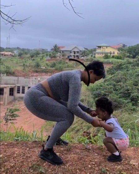 Adorable! Nana Ama McBrown Exercises With Baby Maxin (Watch Video)