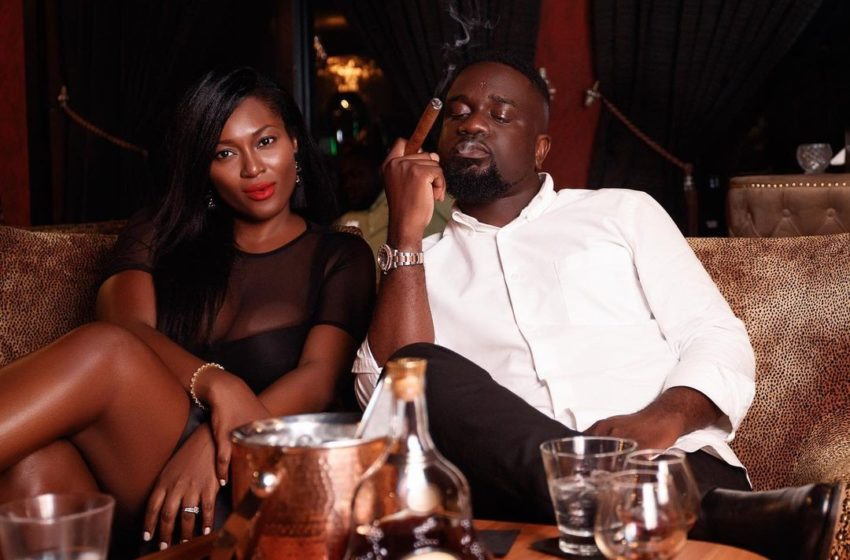Sarkodie And His Wife, Tracy Sarkcess Seen In A Cozy Position Publicly As They Pose With Their New Mercedes Benz