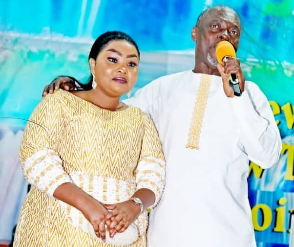 Photos Of Osofo Kyiri Abosom's Beautiful Wife Surface Online As She Consoles Him After He Lost The Elections