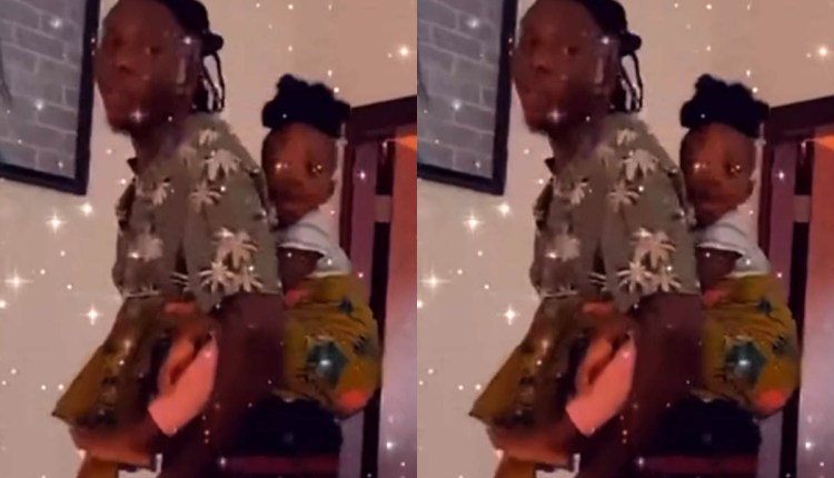 Daddy Goals! Stonebwoy Melts Hearts As He Is Spotted Carrying His Daughter, Jidula On The Back (Video)
