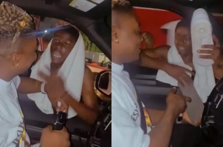 Touching Moment Rapper, AMG Armani Took Of His Sneakers And Gifted Them To A Die-hard Fan In Traffic (Video)